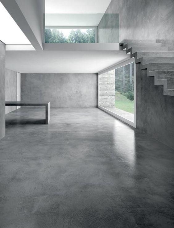 Intérieur moderne et contemporain avec un revêtement de sol en béton ciré